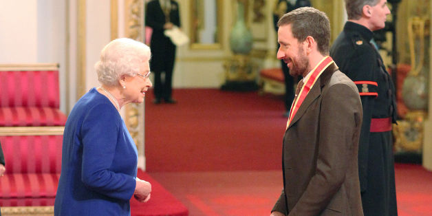 Sir Bradley Wiggins is knighted by Queen Elizabeth II at Buckingham Palace, central London.