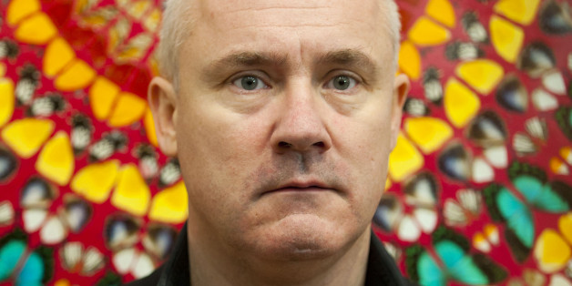 Artist Damien Hirst pictured in front of his work I Am Become Death, Shatterer of Worlds, on display at a retrospective exhibition of his work at the Tate Modern Gallery in London.