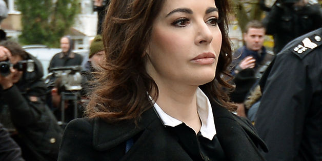 ALTERNATE CROPTV cook Nigella Lawson arriving at Isleworth Crown Court in west London to give evidence in the case two of her former personal assistants, Elisabetta and Francesca Grillo, who are accused of committed fraud by abusing their positions as PAs by using a company credit card for personal gain.