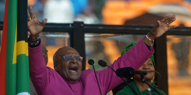 South African Archbishop and Honorary Elders Desmond Tutu speaks during the memorial service of South African former president Nelson Mandela at the FNB Stadium (Soccer City) in Johannesburg on December 10, 2013. Mandela, the revered icon of the anti-apartheid struggle in South Africa and one of the towering political figures of the 20th century, died in Johannesburg on December 5 at age 95.  AFP PHOTO / ALEXANDER JOE        (Photo credit should read ALEXANDER JOE/AFP/Getty Images)