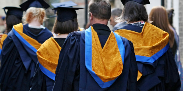 Embargoed to 0001 Thursday October 24 File photo dated 12/10/11 of a general view of students wearing Mortar Boards and Gowns after graduating as rising numbers of young people are choosing to go to university, with women more likely to study for a degree than men, new figures show.