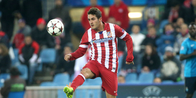 MADRID, SPAIN - DECEMBER 11: Jorge Resurreccion aka Koke of Atletico  in action during the UEFA Champions League match between Atletico de Madrid and FC Porto at the Estadio Vicente Calderon stadium on December 11, 2013 in Madrid, Spain. (Photo by John Berry/Getty Images)