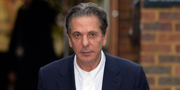 Charles Saatchi leaves Isleworth Crown Court in London, where the trial of sisters Elisabetta 'Lisa' and Francesca Grillo is being held.