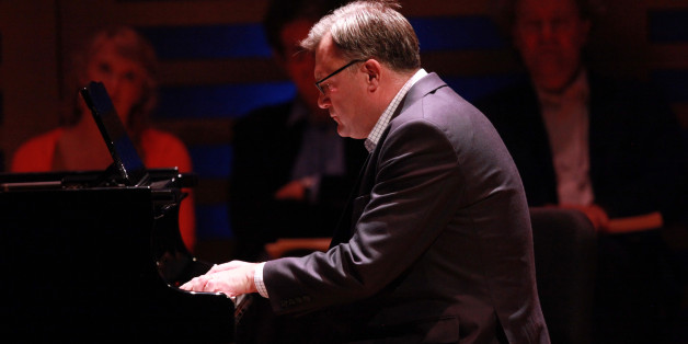 LONDON, ENGLAND - DECEMBER 08:     Labour Party Shadow Chancellor Ed Balls plays on the piano a movement from composer Robert Schumann's Kinderszenen (Scenes from Childhood) on stage during Celebrity Carnival: Lucy Parham & Friends at Kings Place on December 8, 2013 in London, United Kingdom.  (Photo by Amy T. Zielinski/Redferns via Getty Images)