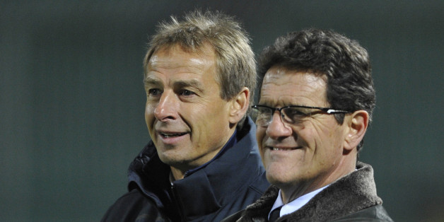 Russian men's national team head coach Fabio Capello (R) speaks with US men's national team head coach Jurgen Klinsmann (L)  before their friendly football match in the southern Russian city of Krasnodar, on November 14,  2012.  AFP PHOTO        (Photo credit should read STR/AFP/Getty Images)