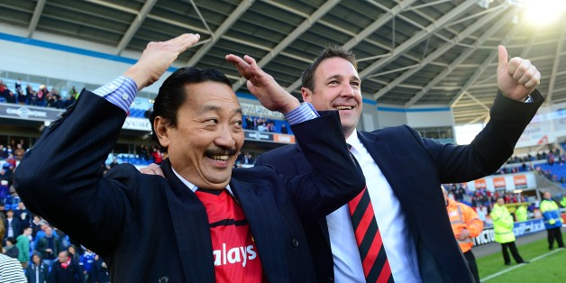Cardiff City Chairman Vincent Tan (left) and manager Malky Mackay winning the npower Football League Championship
