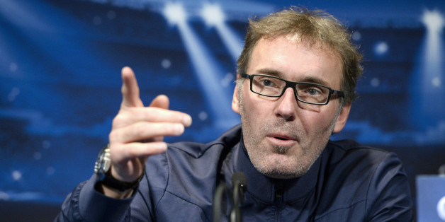 Paris Saint-Germain coach Laurent Blanc gives a press conference at the Parc des Princes stadium in Paris on November 26, 2013, on the eve of the UEFA Champions League football match against Olympiakos. After failing to get the job done in their last group game, Paris Saint-Germain will seek the draw required to qualify for the Champions League last 16 when they host a Kostas Mitroglou-inspired Olympiakos. AFP PHOTO / FRANCK FIFE        (Photo credit should read FRANCK FIFE/AFP/Getty Images)