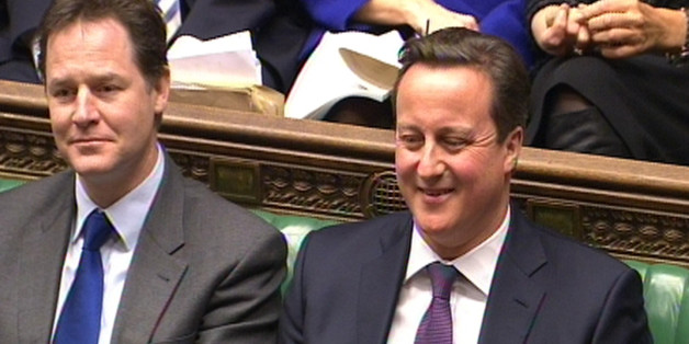 Deputy Prime Minister Nick Clegg and Prime Minister David Cameron during Prime Minister's Questions in the House of Commons, London.