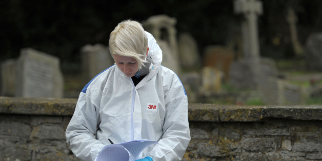 A Forensic officer at the scene at Great Western Cemetery by All Saints' Church in Didcot, Oxfordshire, as Thames Valley Police announced that they are to focus their investigation into the disappearance of 17 -year-old Jayden Parkinson on a specific grave.
