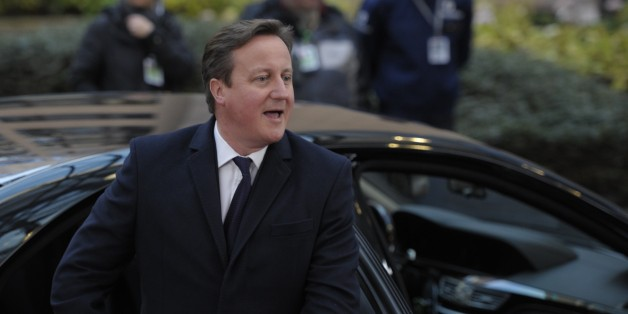 British Prime Minister David Cameron arrives to take part in an EU summit focused on the common security, Defence policy and Economic and Monetary union, in Brussels on December 19, 2013. The European Union took a historic leap towards greater integration just hours ahead of a summit today, with a deal on a banking union to prevent a re-run of the eurozone's recent crisis.           AFP PHOTO / ALAIN JOCARD        (Photo credit should read ALAIN JOCARD/AFP/Getty Images)