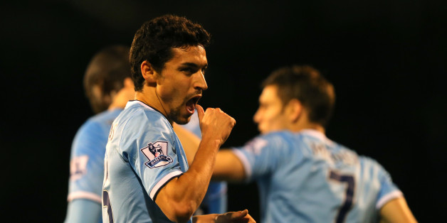 LONDON, ENGLAND - DECEMBER 21:  Jesus Navas of Manchester City celebrates scoring their third goal during the Barclays Premier League match between Fulham and Manchester City at Craven Cottage on December 21, 2013 in London, England.  (Photo by Clive Rose/Getty Images)