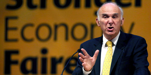 Vince Cable gives a speech after a debate on economy at the Liberal Democrat conference in Glasgow.