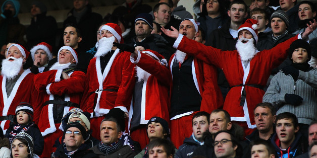 SUNDERLAND, ENGLAND - DECEMBER 18:  Bolton Wanderers supporters dressed as Santa Claus watch from the stands during the Barclays Premier League match between Sunderland and Bolton Wanderers at Stadium of Light on December 18, 2010 in Sunderland, England.  (Photo by Matthew Lewis/Getty Images)