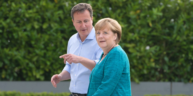British Prime Minister David Cameron (L) greets Germany's Chancellor Angela Merkel (R) during the official arrrivals for the start of the G8 Summit in at the Lough Erne resort near Enniskillen in Northern Ireland on June 17, 2013. The conflict in Syria was set to dominate the G8 summit starting in Northern Ireland on Monday, with Western leaders upping pressure on Russia to back away from its support for President Bashar al-Assad. AFP PHOTO / BERTRAND LANGLOIS        (Photo credit should read BERTRAND LANGLOIS/AFP/Getty Images)