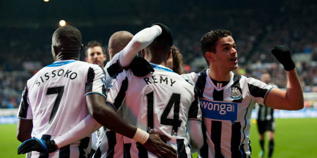 NEWCASTLE, ENGLAND - DECEMBER 26: Newcastle United players Hatem Ben Arfa (R) and Moussa Sissoko (L) celebrate with Loic Remy (C) who scored the second goal  during the Barclays Premier League match between Newcastle United and Stoke City at St. James' Park on December 26, 2013, in Newcastle upon Tyne England. (Photo by Serena Taylor/Newcastle United via Getty Images)