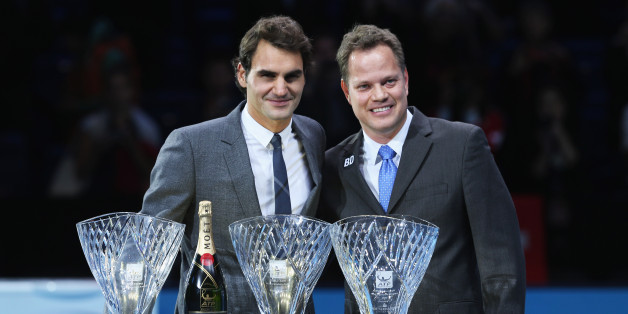 LONDON, ENGLAND - NOVEMBER 06:  Roger Federer of Switzerland poses with the ATPWorldTour.com Fans' Favourite award, the Arthur Ashe Humanitarian of the Year award and the Stefan Edberg Sportsmanship award and Andre Silva, Barclays ATP World Tour Finals Tournament Director during day three of the Barclays ATP World Tour Finals at O2 Arena on November 6, 2013 in London, England.  (Photo by Clive Brunskill/Getty Images)