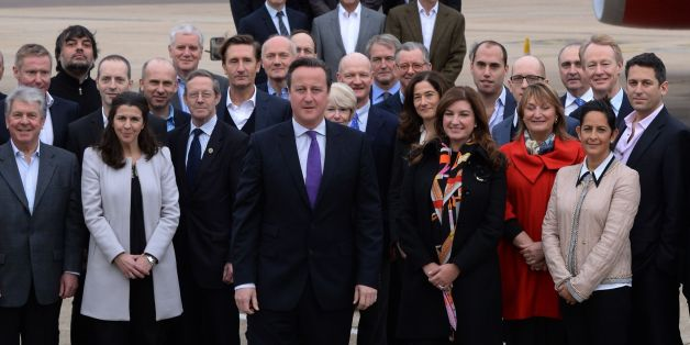 Prime Minister David Cameron (centre front), at Heathrow Airport, prior to heading to Beijing , China, poses with the largest British trade delegation ever to visit the far eastern country for a three day trade visit.
