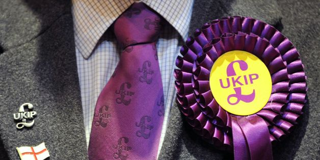 File photo dated 3/5/13 of a UKIP candidate's rosette. The UK Independence Party will fail to achieve its electoral potential because leader Nigel Farage refuses to loosen his grip on power, its former chief executive has said.