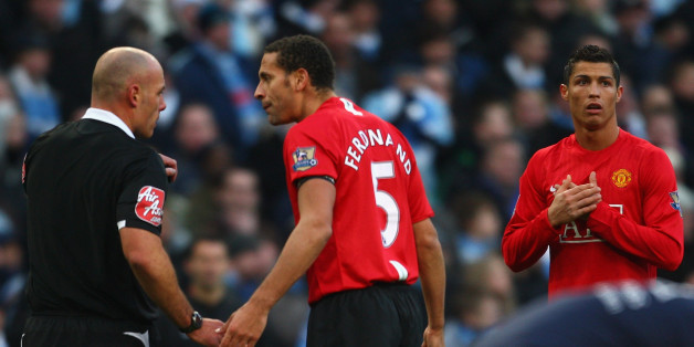 MANCHESTER, UNITED KINGDOM - NOVEMBER 30:  Rio Ferdinand  protests to Referee Howard Webb as Cristiano Ronaldo of Manchester United is sent off  during the Barclays Premier League match between Manchester City and Manchester United at The City of Manchester Stadium on November 30, 2008 in Manchester, England.  (Photo by Jamie McDonald/Getty Images)