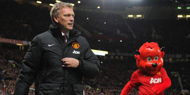 MANCHESTER, ENGLAND - JANUARY 01:  Manchester United Manager David Moyes walks with mascot Fred the Red prior to the Barclays Premier League match between Manchester United and Tottenham Hotspur at Old Trafford on January 1, 2014 in Manchester, England.  (Photo by Michael Regan/Getty Images)