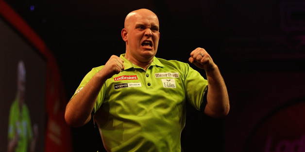 LONDON, ENGLAND - JANUARY 01:  Michael van Gerwen celebrates defeating Peter Wright of Scotland and winning the final of the Ladbrokes.com World Darts Championships at Alexandra Palace on January 1, 2014 in London, England.  (Photo by Ben Hoskins/Getty Images)