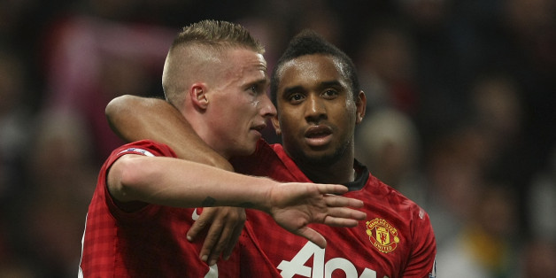 MANCHESTER, ENGLAND - SEPTEMBER 26:  Alexander Buttner (L) and Anderson of Manchester United celebrate Tom Cleverley scoring their second goal during the Capital One Cup Third Round match between Manchester United and Newcastle United at Old Trafford on September 26, 2012 in Manchester, England.  (Photo by John Peters/Man Utd via Getty Images)