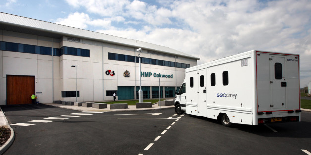 Prisoners are driven to the new prison HMP Oakwood, north of Wolverhampton today.