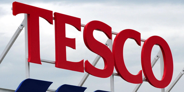 File photo dated 01/08/12 of a Tesco sign as the supermarket chain reported a fresh dip in quarterly sales.