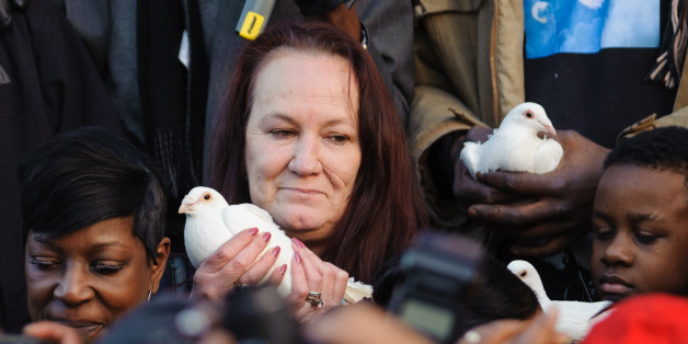 Mother of Mark Duggan, prepares to release a white dove at a vigil in his memory