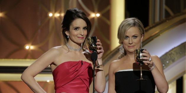 Hosts Tina Fey and Amy Poehler speak onstage during the 71st Annual Golden Globe Award at The Beverly Hilton Hotel on January 12, 2014 in Beverly Hills, California.  (Photo by Paul Drinkwater/NBCUniversal via Getty Images)