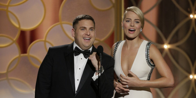 Presenters Jonah Hill and Margot Robbie speak onstage during the 71st Annual Golden Globe Award at The Beverly Hilton Hotel on January 12, 2014 in Beverly Hills, California.  (Photo by Paul Drinkwater/NBCUniversal via Getty Images)