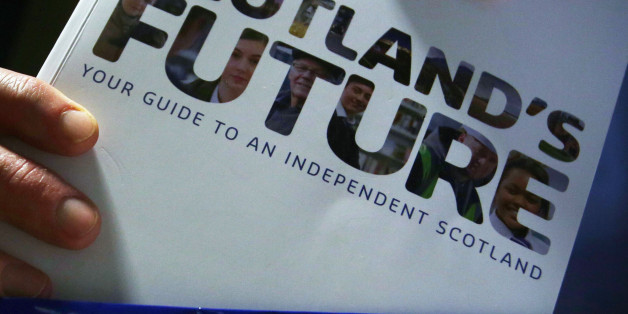 File photo dated 26/11/13 of a person holding the Scottish Government's white paper on independence as two-thirds of Scots find it difficult to decide if information provided ahead of the independence referendum is true or not, a new poll has found.