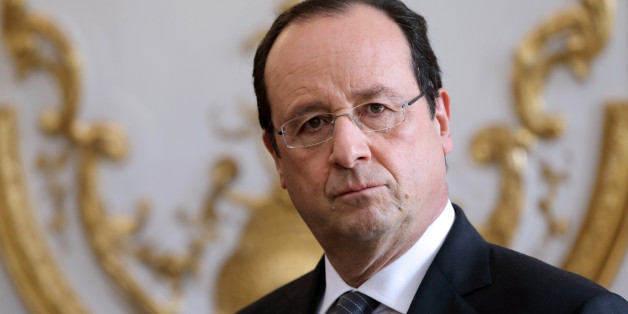 French President Francois Hollande listens to the speech of French Prime Minister during a new year ceremony with members of the government at the Elysee Palace in Paris on January 3, 2014.    AFP PHOTO / POOL / PHILIPPE WOJAZER        (Photo credit should read PHILIPPE WOJAZER/AFP/Getty Images)