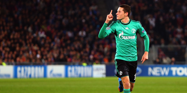 Schalke's midfielder Julian Draxler celebrates after scoring during the UEFA Champions League group E football match FC Schalke 04 vs FC Basel 1893 in Gelsenkirchen, Germany, on December 11, 2013. AFP PHOTO / PATRIK STOLLARZ        (Photo credit should read PATRIK STOLLARZ/AFP/Getty Images)