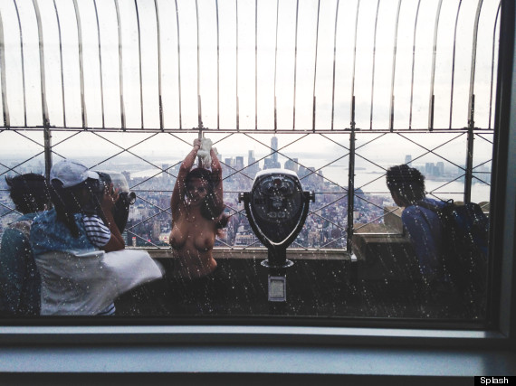 topless model on empire state building