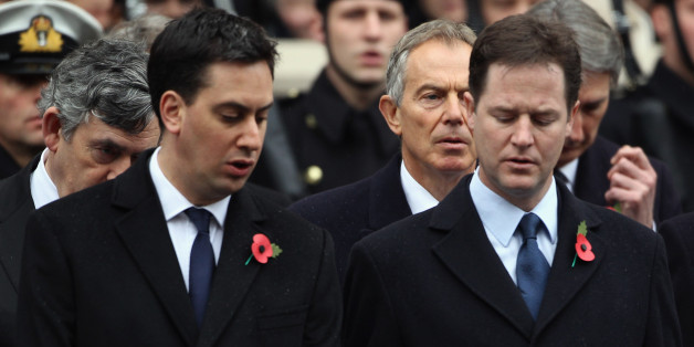 LONDON, ENGLAND - NOVEMBER 14:  (L-R) Labour leader Ed Miliband and Leader of the Liberal Democrats Nick Clegg share a hymn sheet as Former British Prime Ministers Gordon Brown and Tony Blair are seen behind them at the Cenotaph during Remembrance Sunday in Whitehall, on November 14, 2010 in London, England. Remembrance Sunday tributes were carried out across the nation to pay respects to all who those who lost their lives in current and past conflicts, including the First and Second World Wars.