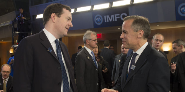 Governor of the Bank of England Mark Carney (R) talks with British Finance Minister George Osborne (L) during annual IMF/World Bank meetings in Washington, DC, October 12, 2013.    AFP PHOTO / Jim WATSON        (Photo credit should read JIM WATSON/AFP/Getty Images)