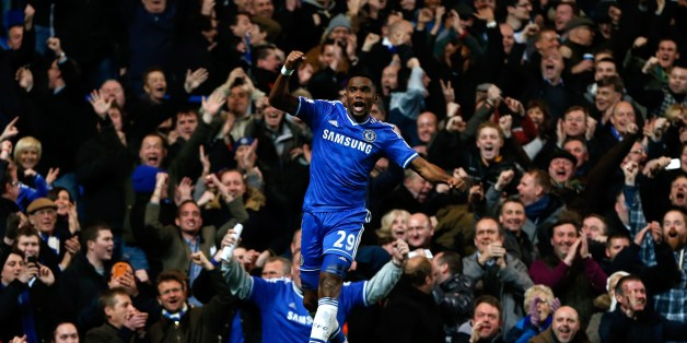 Chelsea's Cameroonian striker Samuel Eto'o celebrates scoring his third goal and completing his hattrick during the English Premier League football match between Chelsea and Manchester United at Stamford Bridge in London on January 19, 2014.  AFP PHOTO / ADRIAN DENNIS