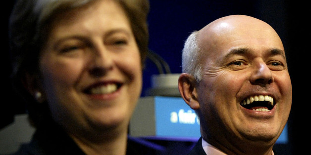 BLACKPOOL, ENGLAND - OCTOBER 6:  Theresa May, the Conservative Party Chairman (L) and party leader Iain Duncan Smith laugh at the annual Conservative Party conference October 6, 2003 in Blackpool, England. Duncan Smith has expressed condfidence over the Conservative party's prospects, with polls having the Tories closer to the Labour party than they have been for some time. (Photo by Graeme Robertson/Getty Images)