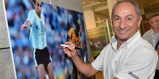MONACO - OCTOBER 16:  Osvaldo Ardiles signs a picture prior to the Golden Foot Award press conference at Grimaldi Forum on October 16, 2013 in Monaco, Monaco.  (Photo by Tullio M. Puglia/Getty Images for Golden Foot)