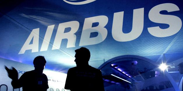 People are silhouetted at the Airbus aviation stand at Farnborough Airshow, 16 July 2006. The Airshow which takes place every two years at Farnborough is a chance for the International Aviation Industry to showcase their latest products and technology. European group Airbus will on Monday 17 July unveil new design plans for its troubled long-haul A350 plane, Thomas Enders, co-chief executive of Airbus's parent company EADS, told reporters. (Photo credit should read CARL DE SOUZA/AFP/Getty Images