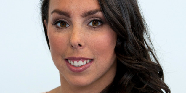 LONDON, UNITED KINGDOM - AUGUST 06: Gymnast Beth Tweddle attends a photocall after announcing her retirement at Chobham Academy on August 6, 2013 in London, England. (Photo by John Phillips/UK Press via Getty Images)