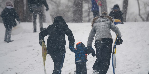 NEW YORK, UNITED STATES - JANUARY 21: People enjoy during the snow storm in  New York City, United States, January 21, 2014. Winter storm Hercules has brought heavy snowfall and freezing temperatures to especially southeastern United States. (Photo by Cem Ozdel/Anadolu Agency/Getty Images)
