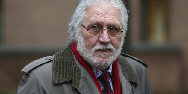LONDON, ENGLAND - JANUARY 20:  Radio presenter Dave Lee Travis arrives at Southwark Crown Court on January 20, 2014 in London, England. Dave Lee Travis, whose real name is David Patrick Griffin, is charged with 14 counts of indecent assaults and one of sexual assault, which allegedly took place between 1977 and 2007 against victims aged between 15 and 29. Dave Lee Travis entered a not guilty plea to the charges in October last year.   (Photo by Oli Scarff/Getty Images)