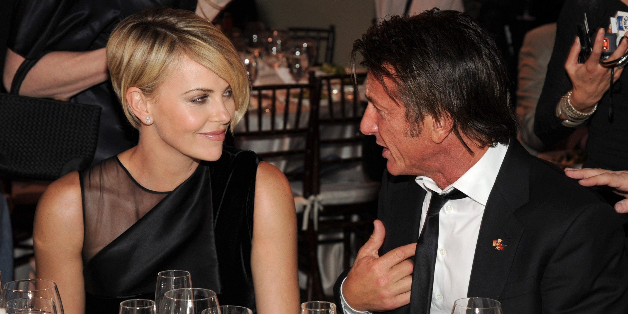 sean penn and charlize theron are indeed dating penn calls the beauty a keeper huffpost
