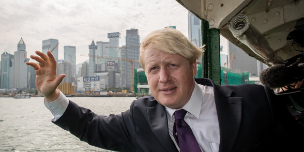 London Mayor Boris Johnson waves as he crosses Victoria Harbour on a Star Ferry during his visit in Hong Kong on October 18, 2013. Johnson is in the former British colony on the last leg of a trade mission to China from 13-18 October 2013 aimed at promoting London as a major investment destination.  AFP PHOTO / Philippe Lopez        (Photo credit should read PHILIPPE LOPEZ/AFP/Getty Images)