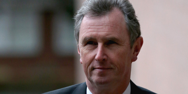 PRESTON, LANCASHIRE - JANUARY 24:  Former Deputy Speaker Nigel Evans arrives at Preston Crown Court for a a pre-trial hearing to face charges of sexual assault on January 24, 2014 in Preston, Lancashire. Mr Evans resigned from his position as the House of Commons deputy speaker last year. The MP for Ribble Valley has been charged with two counts of indecent assault, five of sexual assault, and one of rape against seven alleged male victims.  (Photo by Christopher Furlong/Getty Images)