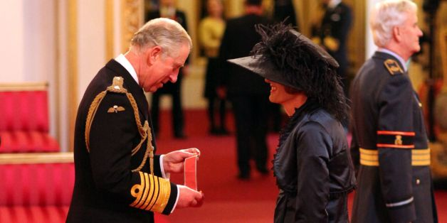 Artist Grayson Perry is made a CBE by the Prince of Wales during an investiture ceremony at Buckingham Palace, London.