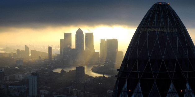 Embargoed to 0001 Monday January 20 File photo dated 25/02/10 of the 'Gherkin' and Canary Wharf at sunrise in the City of London as economic recovery is starting to feed through to the financial services sector, with rising profits and jobs, a new study has shown.