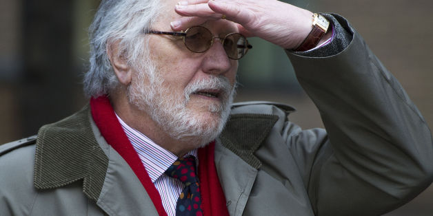 DJ Dave Lee Travis arrives at Southwark Crown Court in London where he is accused of a series of indecent assaults and one sexual assault.